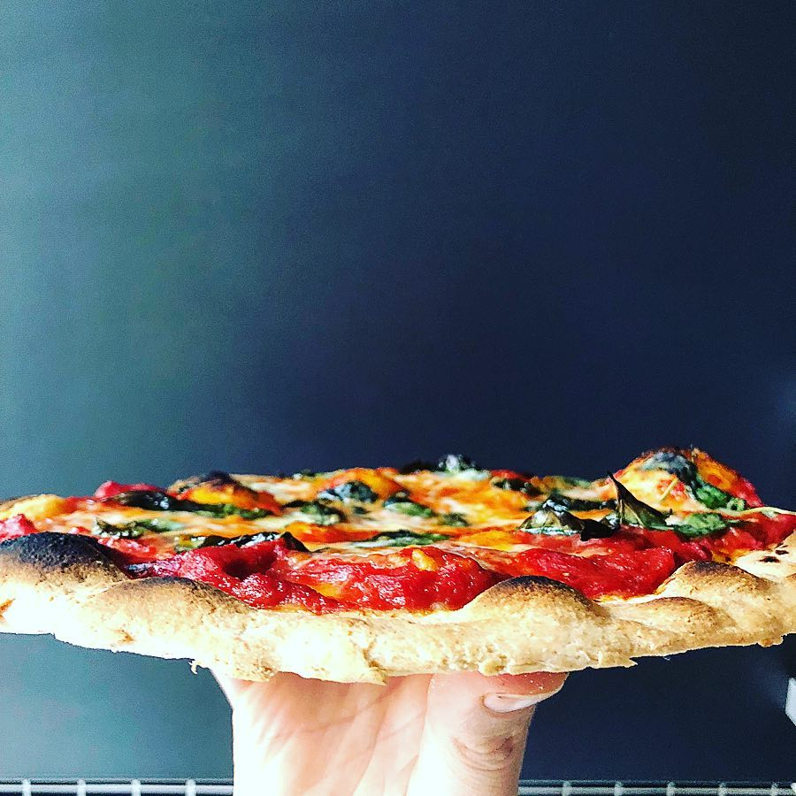 side view of crispy perfect pizza crust