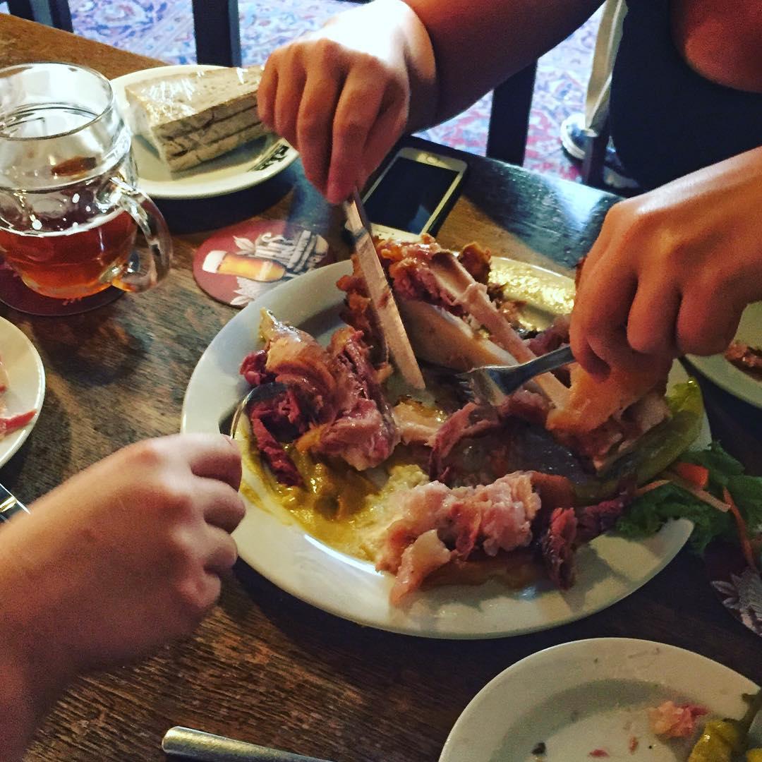 eating roast pork knee in Prague
